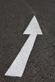 Arrow on road. White painted directional arrow on asphalt road Royalty Free Stock Photo