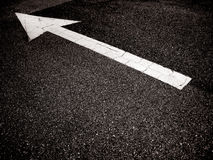 Arrow on the road Royalty Free Stock Photo