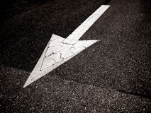 Arrow on the road Stock Photography