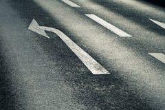 Arrow on the road Stock Photos