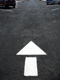 Arrow on Road for Cars to Follow Royalty Free Stock Image
