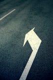 Arrow on the road Stock Photo