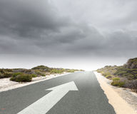 Arrow on road Stock Images
