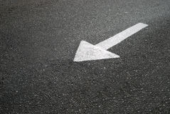 Arrow a road marking on asphalt Royalty Free Stock Photography