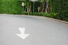 Arrow on road near convex mirror Royalty Free Stock Images