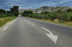 Arrow on the road in Provence, France Royalty Free Stock Photos