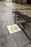 Arrow of the road of santiago. In building wall, sign and symbol Royalty Free Stock Photography