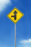 Arrow road sign. Arrow yellow road sign on sky background Stock Photography