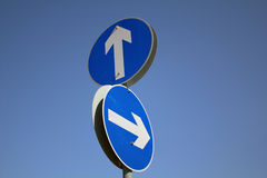Arrow road sign pointing at different directions Royalty Free Stock Photos
