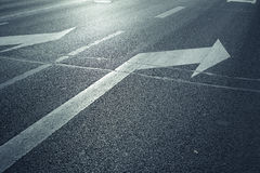 Arrow on the road. Turn right Stock Photos