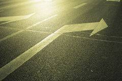 Arrow on the road. Turn right Stock Image