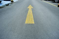 Arrow on the road, yellow colour photo Royalty Free Stock Photography