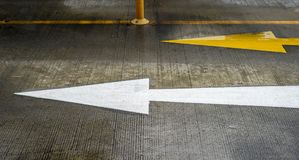Arrow on the road with yellow and white color Royalty Free Stock Image