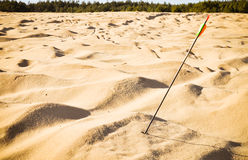 Arrow in the sand. Wasted shot. Sport arrow in the sand can symbolize missed target, wasted chance, lack of life aims, nothingness royalty free stock photography
