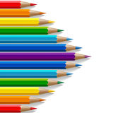 Arrow shape of rainbow colored pencils with Stock Photo