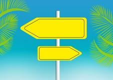 Arrow-shaped sign on the beach Stock Photos