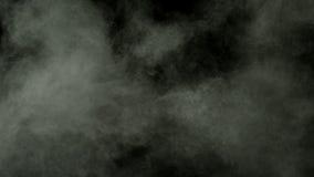 Arrow shooting through a dust covered balloon stock video