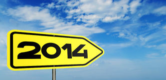 Arrow sign for 2014 against sky Royalty Free Stock Image