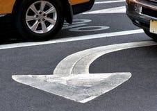 Arrow sign on asphalt Stock Image