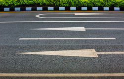 3 Arrow sign on asphalt surface Stock Photography