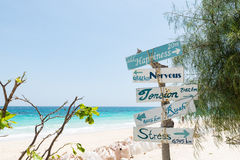 Arrow sign with clear blue sea, white sand and blue sky Stock Photography