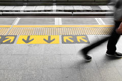 Arrow sign on floor Stock Photo