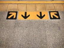 Arrow sign on floor Stock Image