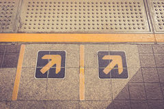 Arrow sign on floor at the sky train Stock Image