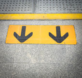 Arrow sign on floor at the sky train. Pic of Arrow sign on floor at the sky train Stock Photography