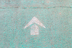 Arrow sign on footpath Stock Photos