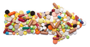 Arrow sign made of pills, capsules and tablets Royalty Free Stock Image
