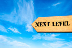 Arrow sign with Next Level message Stock Photography