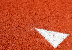 A arrow sign on running track Stock Photography