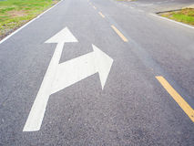 Arrow sign on the street. With sunlight royalty free stock photo