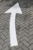 Arrow sign on street, turn right on asphalt. Arrow sign on street, go forward on asphalt. Background for web site or mobile devices stock images