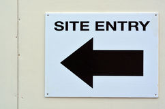 Arrow sign to site entry Royalty Free Stock Images