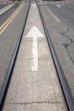 Arrow Sign in between Tram Tracks in Helsinki Stock Photos