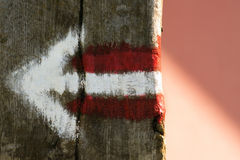Arrow sign on wooden board. Old arrow sign painted on wooden board Stock Photo
