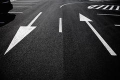 Arrow signs as road markings on a street Royalty Free Stock Image