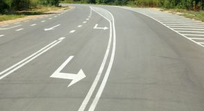 Arrow signs as road markings on suburban driveway. Arrow signs as road markings on a suburban driveway Stock Images
