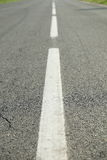 Arrow signs as road markings on suburban driveway Royalty Free Stock Images