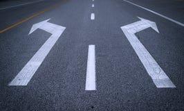Arrow signs on asphalt Royalty Free Stock Photos
