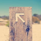 Arrow Signs Instagram Style. Arrow signs outside pointing the way on a walking trail stock photos