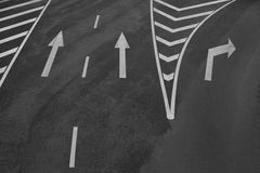 Arrow signs and other road markings Royalty Free Stock Photography