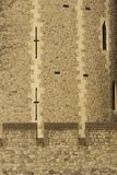 Arrow Slits. Detail of arrow slits in the walls of the Tower of London. Historic fortress on the bank of the River Thames in London, England Stock Image