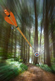 Arrow speeding to archery target with motion blur, part photo, part 3D rendering Stock Images