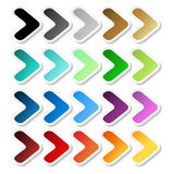 Arrow stickers. Black, grey, silver, dark, golden, cyan, turquoise, blue, green, purple, red, orange and yellow label with white o Royalty Free Stock Images