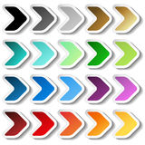 Arrow stickers. Black, grey, silver, dark, golden, cyan, turquoise, blue, green, purple, red, orange and yellow label with white o Stock Photography