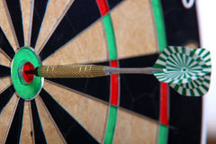 Arrow Stiffed In The Center. Arrow Stiffed Right In The Middle Of Darts Board Stock Photos