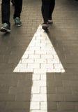 Arrow straight on walking street Stock Images